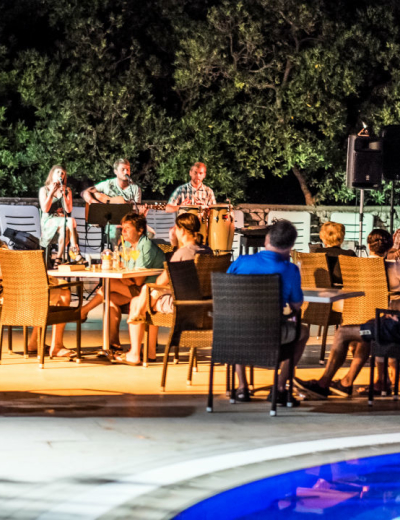 Evening entertainment by the pool at Dražica hotel in Krk