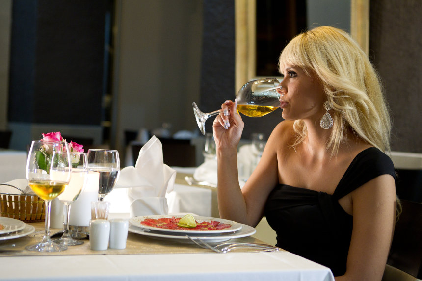 Savoring a delicious dish over a glass of wine